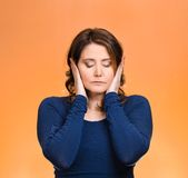 Woman, covering ears. Hear no evil concept Stock Photography