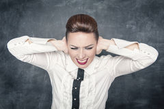 Woman covering ears with her hands Royalty Free Stock Image