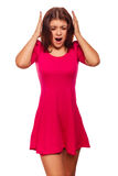 Woman covering ears with her hands screaming Royalty Free Stock Photography