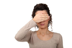 Woman covering eyes Royalty Free Stock Image