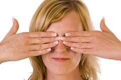 Woman covering eyes Stock Photography