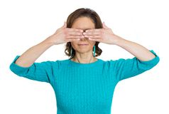 Woman covering eyes Stock Images