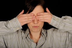 Woman covering eyes Stock Photo