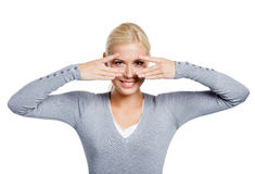 Woman covering eyes with hands Stock Images