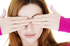 Woman covering eyes with her hands Stock Photos