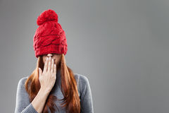 Woman Covering Eyes with Red Bonnet Stock Photos