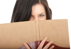 Woman covering face book Royalty Free Stock Image