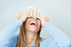 Woman covering face with hat Royalty Free Stock Photography