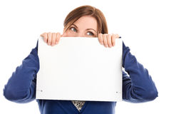 Woman covering face with note card Royalty Free Stock Images