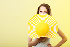 Woman covering face with yellow summer hat. Stock Images