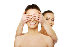 Woman covering friend's eyes. Royalty Free Stock Photo