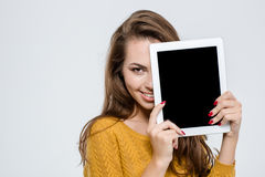 Woman covering half face with tablet computer Stock Image