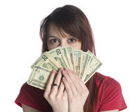 Woman Covering Half Face with 20 US Dollar Bills Royalty Free Stock Photo