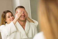 Woman covering her boyfriends eyes Royalty Free Stock Photography