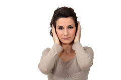 Woman covering her ears Royalty Free Stock Images