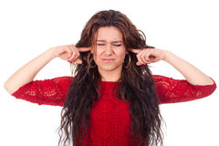 Woman covering her ears and annoyed by so much noise Royalty Free Stock Images