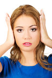 Woman covering her ears. Stock Photos