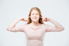 Woman covering her ears with fingers Royalty Free Stock Photography