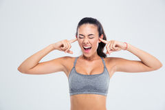 Woman covering her ears with fingers and screaming Stock Images