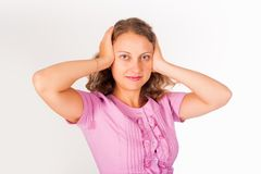 Hear no evil - Young woman covering her ears Royalty Free Stock Images