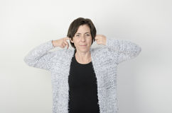 Woman covering her ears with her fingers. Royalty Free Stock Photos