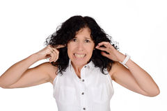 Woman covering her ears. Royalty Free Stock Photography