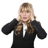 Woman covering her ears with a shocked expression Royalty Free Stock Photos