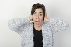 Woman is covering her ears Royalty Free Stock Image