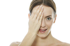 Woman covering her eye Stock Images
