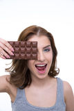Woman covering her eye with chocolate bar Stock Photography