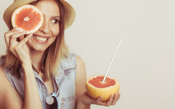 Woman covering her eye with grapefruit. Fun summer Stock Photos