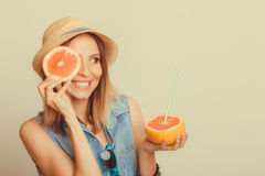 Woman covering her eye with grapefruit. Fun summer Stock Images