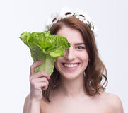 Woman covering her eye with salad Royalty Free Stock Photo