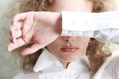 Woman covering her eyes. Young woman covering her eyes stock images