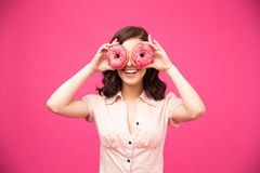 Woman covering her eyes with donut Royalty Free Stock Image
