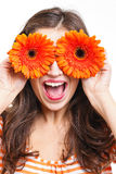 Woman covering her eyes with flowers Royalty Free Stock Photos