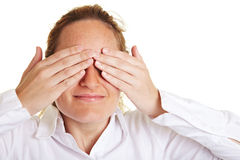 Woman covering her eyes with hands Stock Image