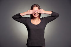 Woman covering her eyes by hands Stock Photography