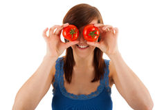 The woman is covering her eyes with tomatoes Stock Photography