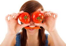 The woman is covering her eyes with tomatoes Stock Photos
