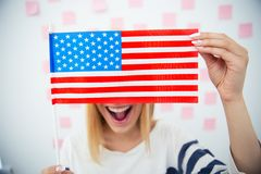 Woman covering her eyes with USA flag Stock Images