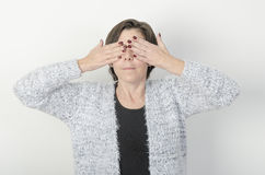 Woman is covering her eyes. Stock Photography