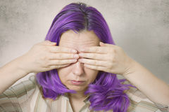 Woman covering her eyes Royalty Free Stock Images