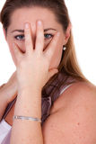 Woman is covering her face Royalty Free Stock Photos