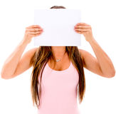 Woman covering her face Stock Photo