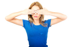 Woman covering her face with both hands. Stock Images
