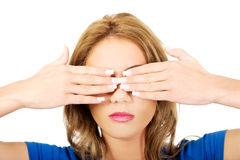 Woman covering her face with both hands. Royalty Free Stock Image