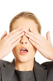 Woman covering her face with both hands Royalty Free Stock Image