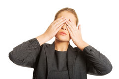 Woman covering her face with both hands Stock Photo