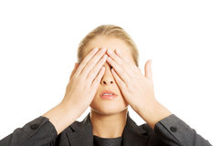 Woman covering her face with both hands. Blonde woman covering her face with both hands royalty free stock photos